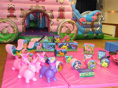 Royal Princesses Carriage Bouncy Castle with a small Slide on the side & Unicorns Soft Play