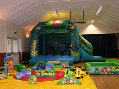 Jungle Madness Bouncy Castle with small Slide on the side and Jungle Soft Play